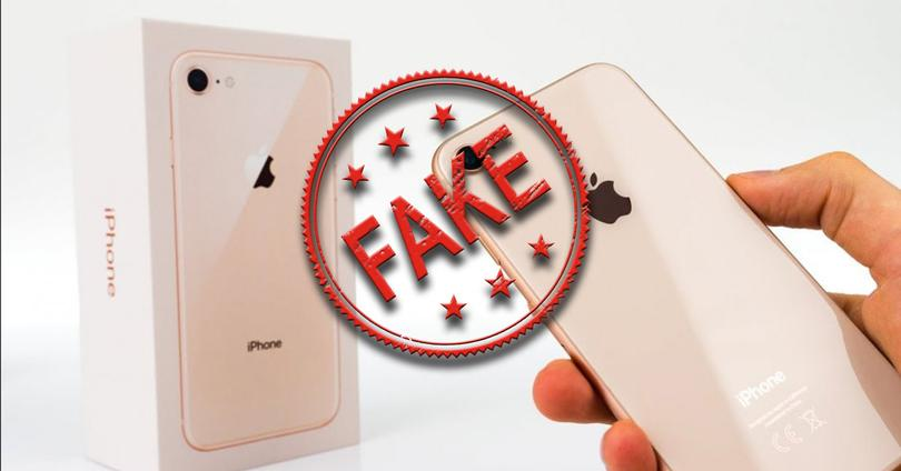 Icono Fake en color rojo sobre un iPhone 8