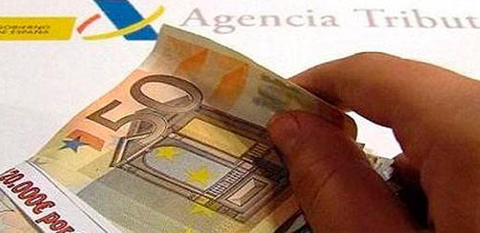 billete de 50 euros y logo de hacienda declaracion de la renta 2017