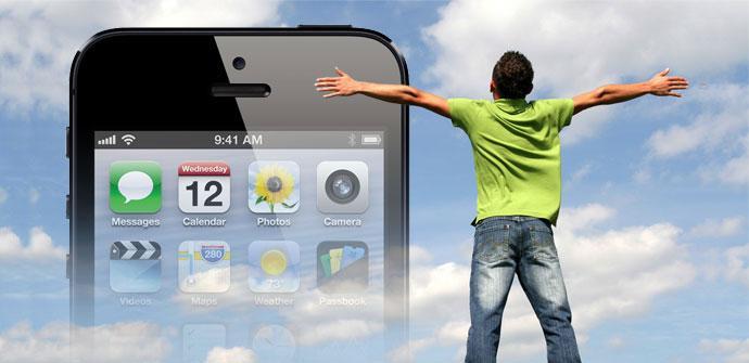 iPhone negro sobre fondo azul con nubes