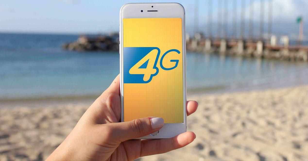 iPhone 6 blanco en la playa con logo 4G