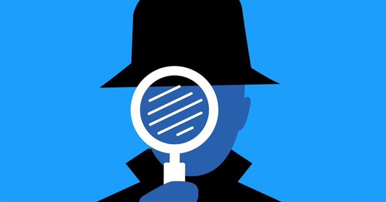 espia sobre fondo azul