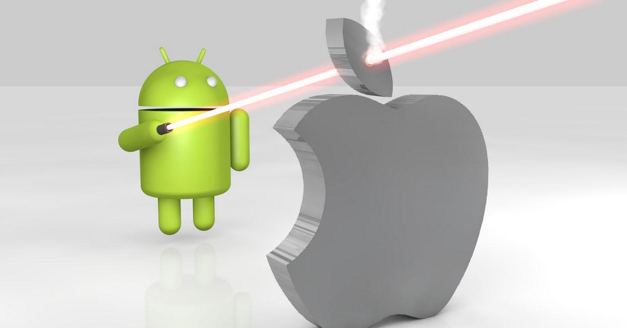 Robot Android disparando un láser al logo de la manzana de Apple