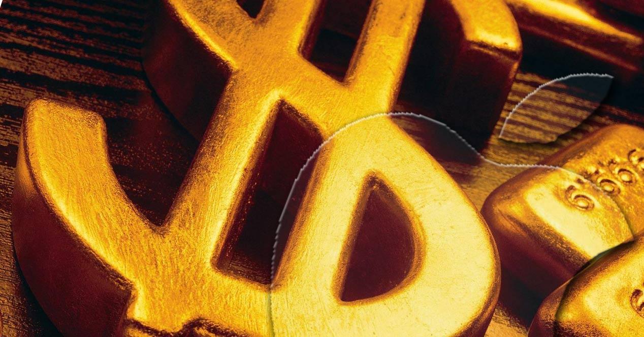 Logo de Apple y del dólar
