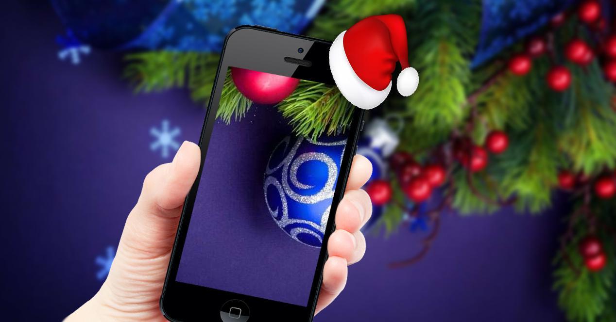 móvil con fondo de navidad y gorro de papá noel