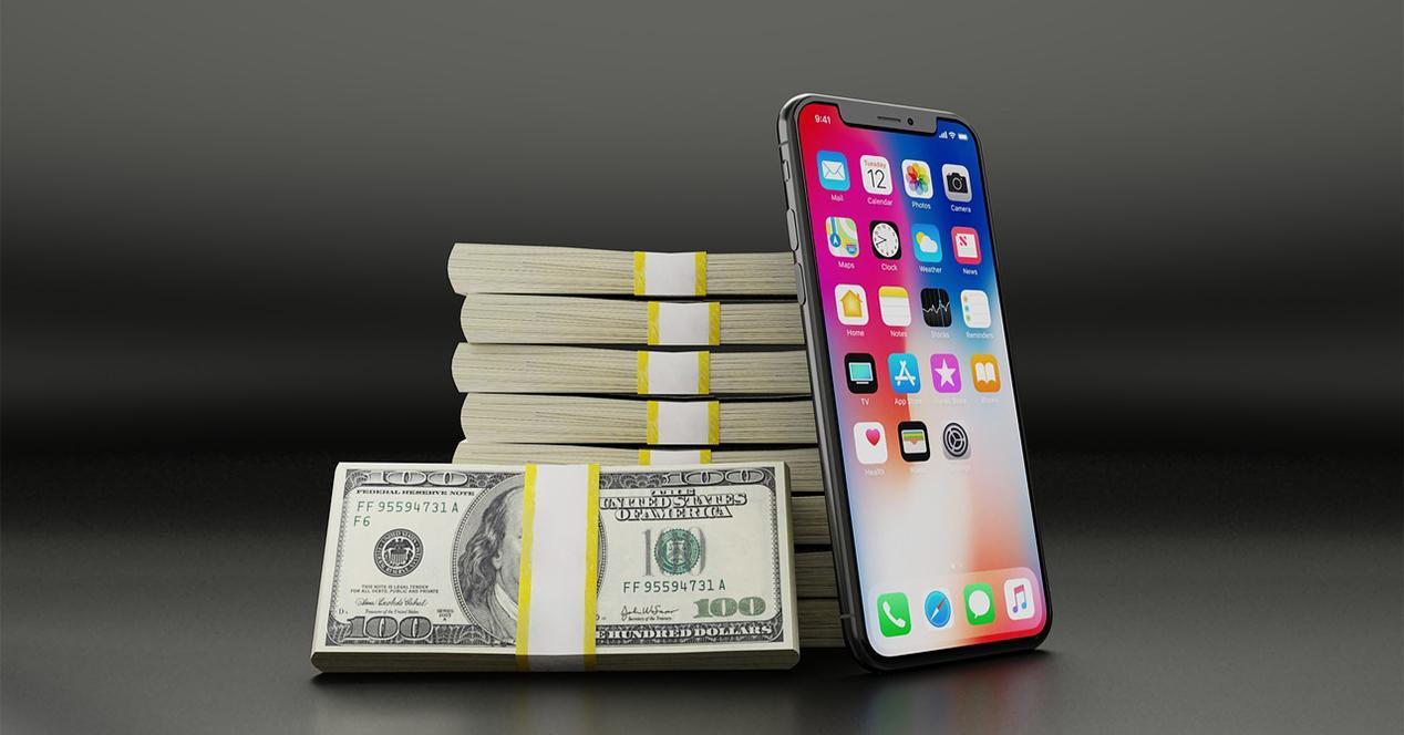 iPhone X junto a billetes de dolar