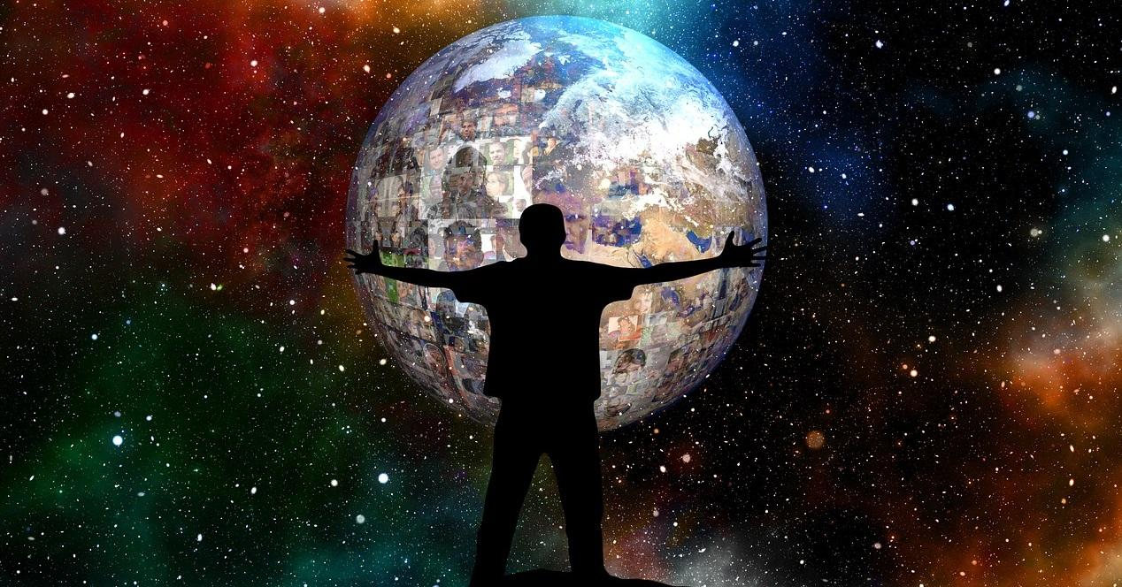 hombre abraza al mundo y contactos